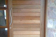 Solid Horizontal Slatted Pivot Door